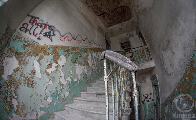 decayed staircase in an abandoned house