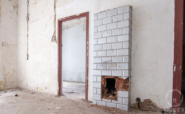 tiled stove in an abandoned building
