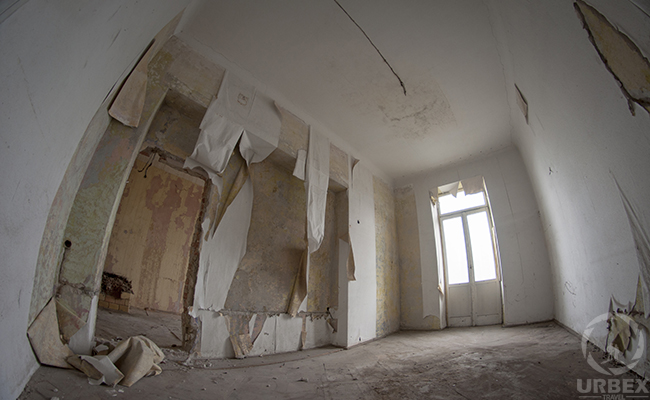 white room in an abandoned tenement house