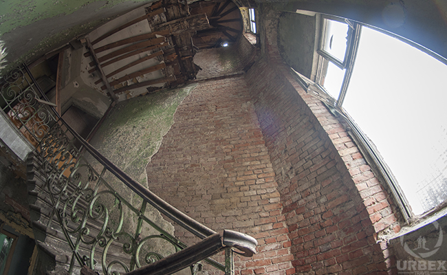 decyed staircase in an abandoned tenement house