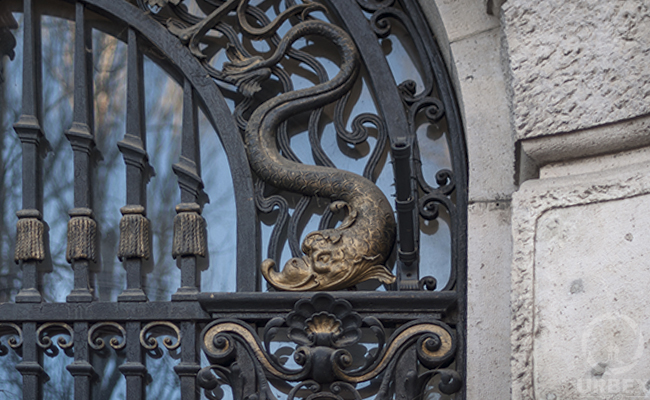 sea ornaments on the gate of an abandoned palace in Budapest