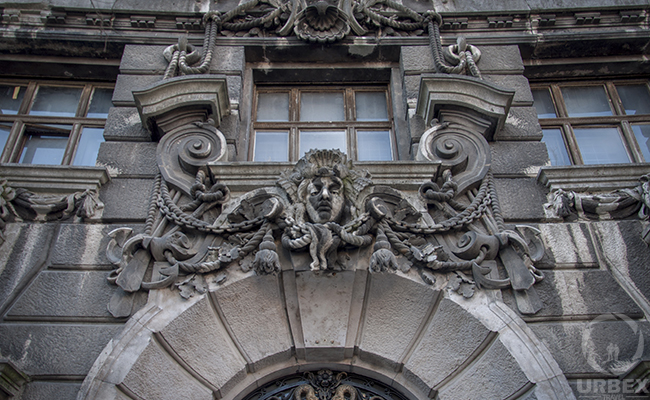 a Medusa on the facade of an abandoned palace in Budapest