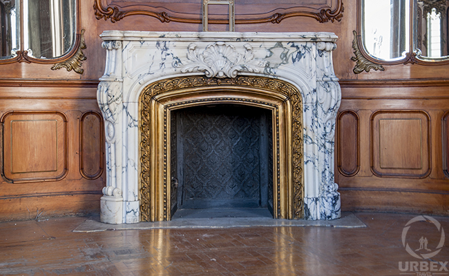 white marble fireplace in an abandoned palace