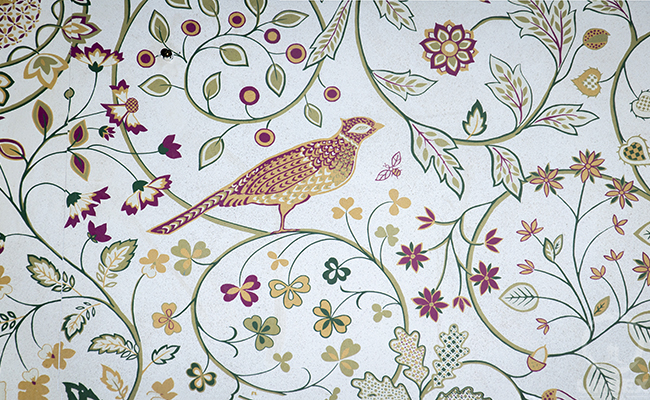 birds on the wallpaper in an abandoned palace