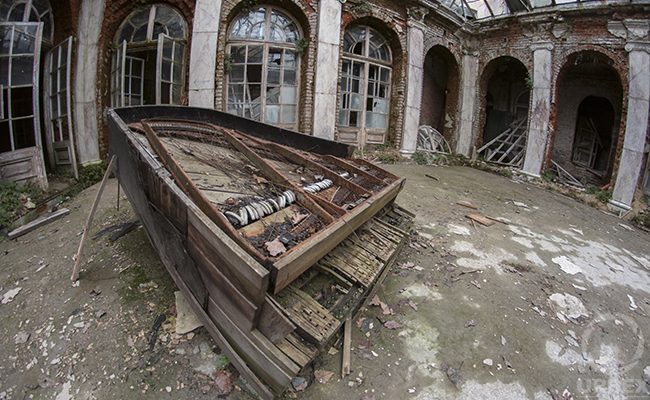 decaying piano in abandoned palace