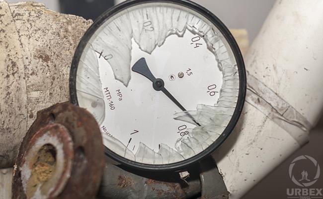 manometer in abandoned boiler room