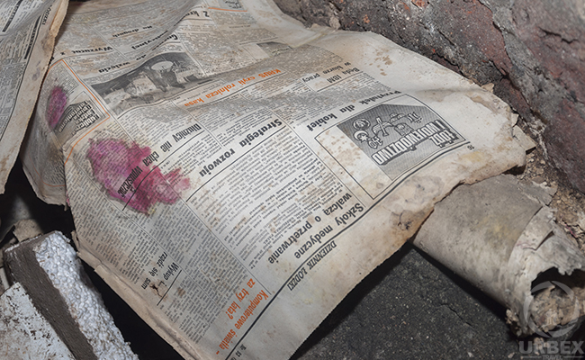 old newspapers in abandoned palace
