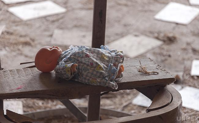 creepy infant doll on urbex