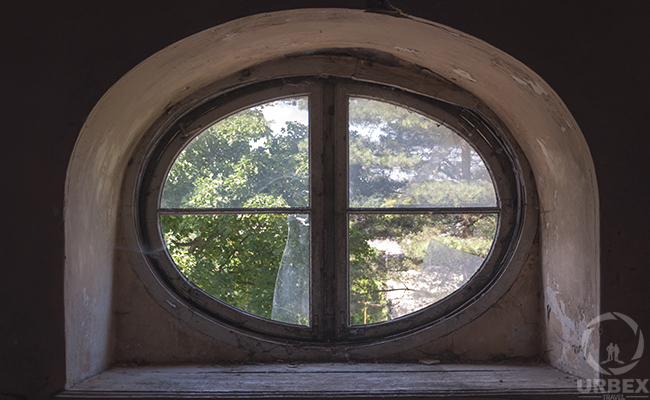 oval window in an abandoned mansion