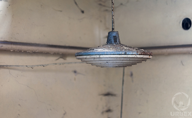 hanging lamp in an abandoned building