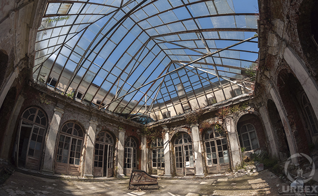 glass roof in abandoned mansion