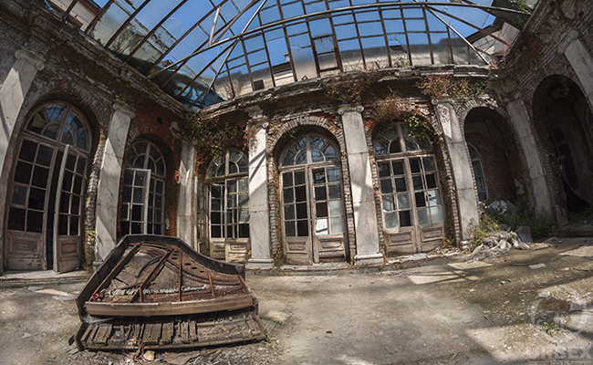 an abandoned palace with sunny patio