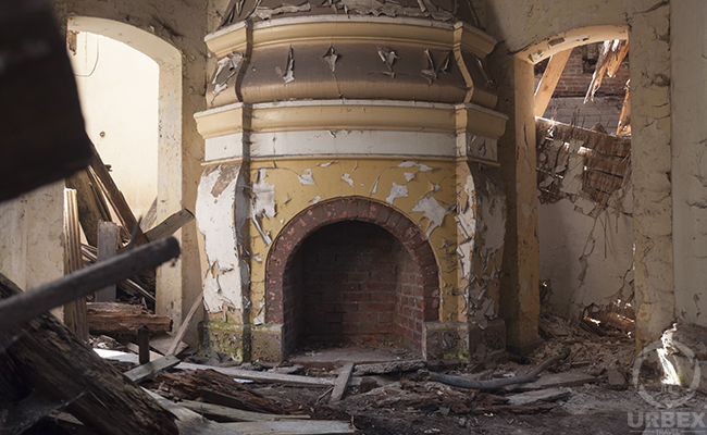 fireplace in an abandoned mansion