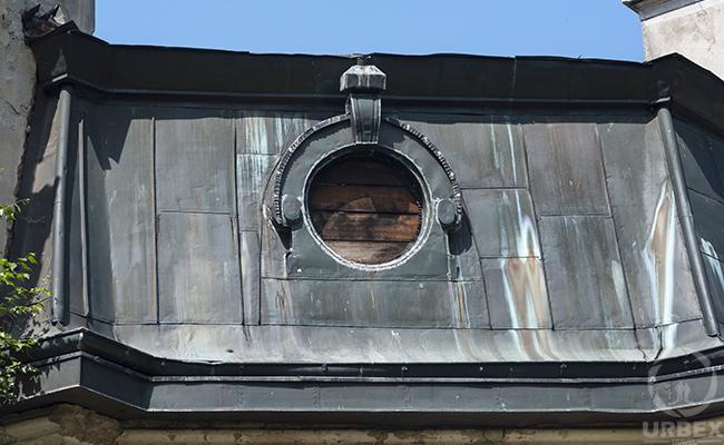 brocken window in abandoned mansion