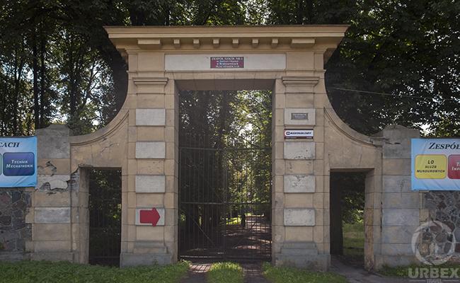gates of abandoned palace in poland