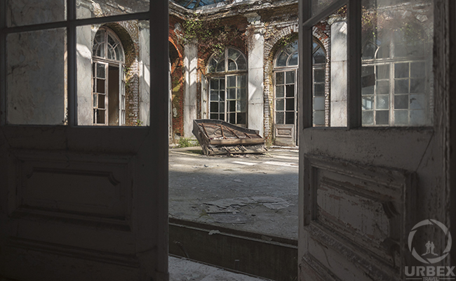 glass patio in abandoned mansion