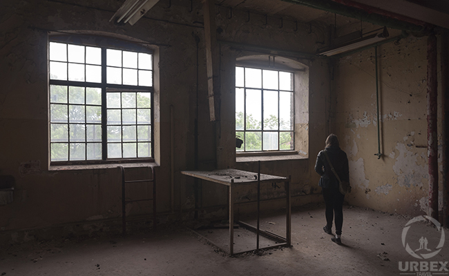 large windows in abandoned factory