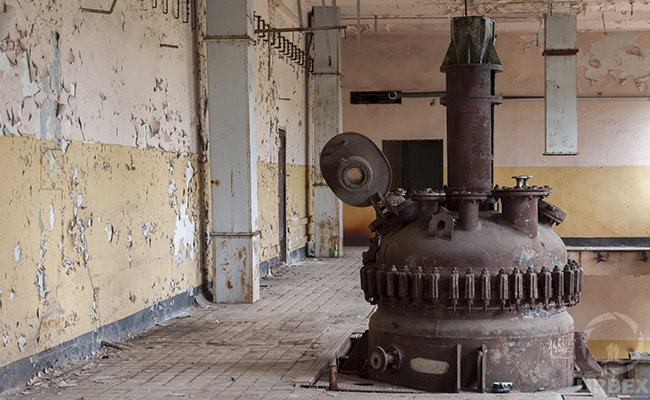 rusty reactor in an abandoned factory