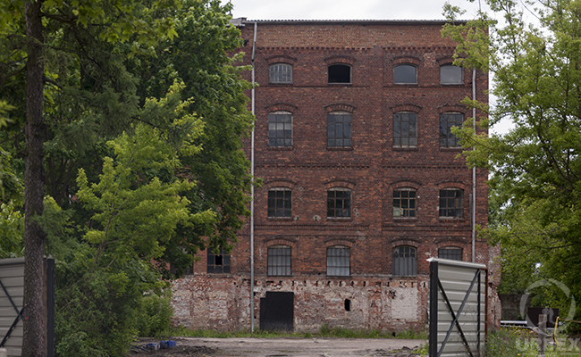 a summer urbex photo of a brick building