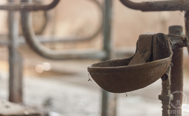 rusty device in an abandoned farm