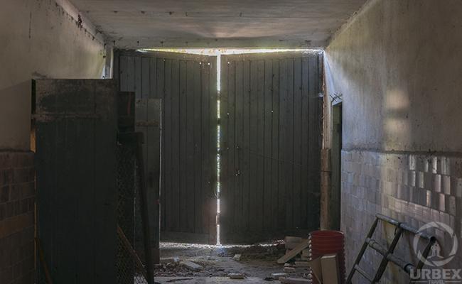 broken doors in an abandoned farm