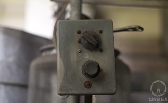 broken machine in an abandoned building