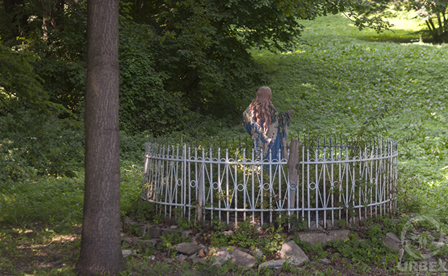 a statue of the Mother of God in an abandoned palace park in Pilica