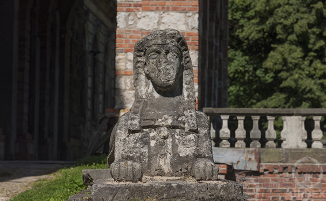 figure of a sphinx in an abandoned palace