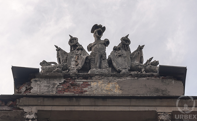 sculptures on the roof of an abandoned palace in Pilica