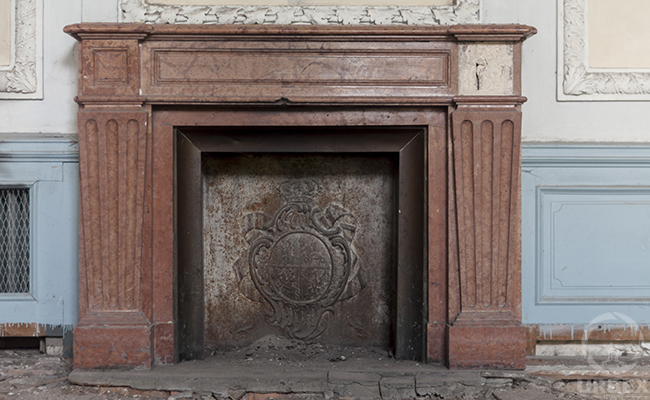 fireplace in an abandoned palace in Poland