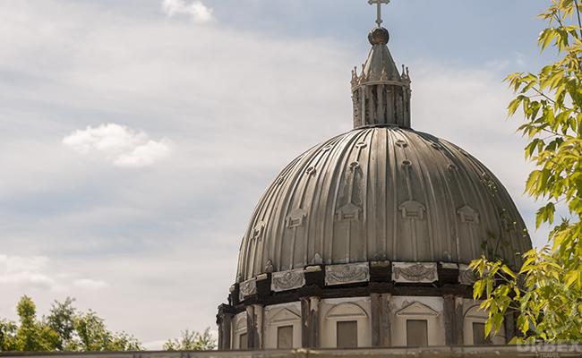 abandoned poland mausoleum with casket