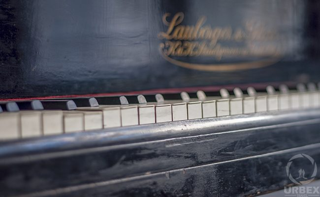 a piano in an abandoned chateau