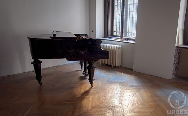 a piano in an abandoned palace