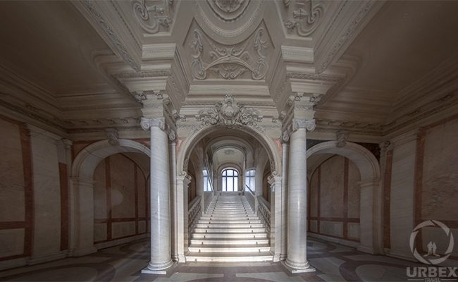 beautiful stairway in an abandoned palace