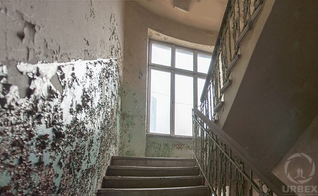urbex staircase in abandoned tenement house