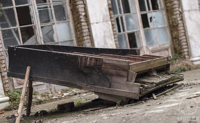 piano in abandoned mansion