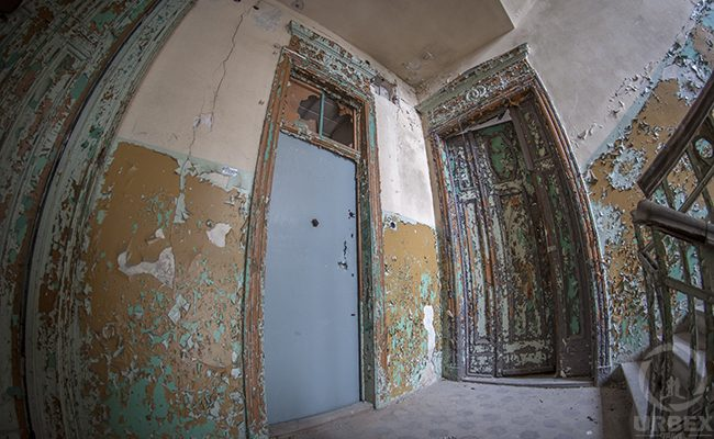 decayed doors in abandoned building