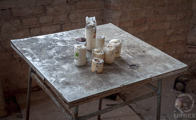 candles on the table in an abandoned building