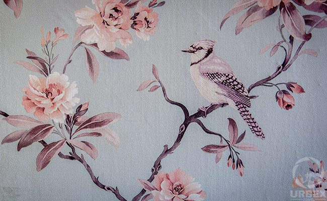 skylark between folwers on the wallpaper in abandoned palace