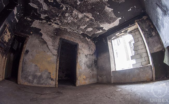 burned room in abandoned tenement house