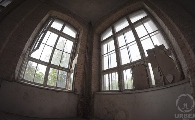 windows in an abandoned building fisheye lens